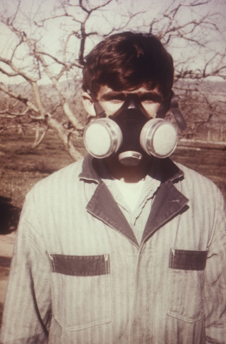 This individual was demonstrating the types of protective clothing worn by pesticide workers during the 1970's.