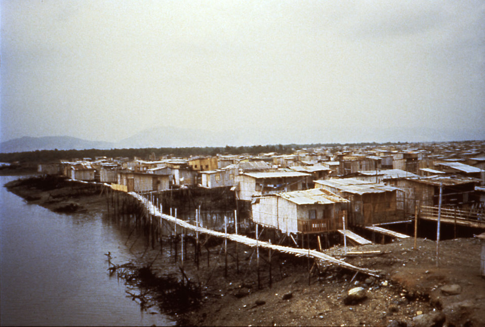 This slide shows a slum in Ecuador that was heavily affected by cholera due to its proximity to unsafe water sources.