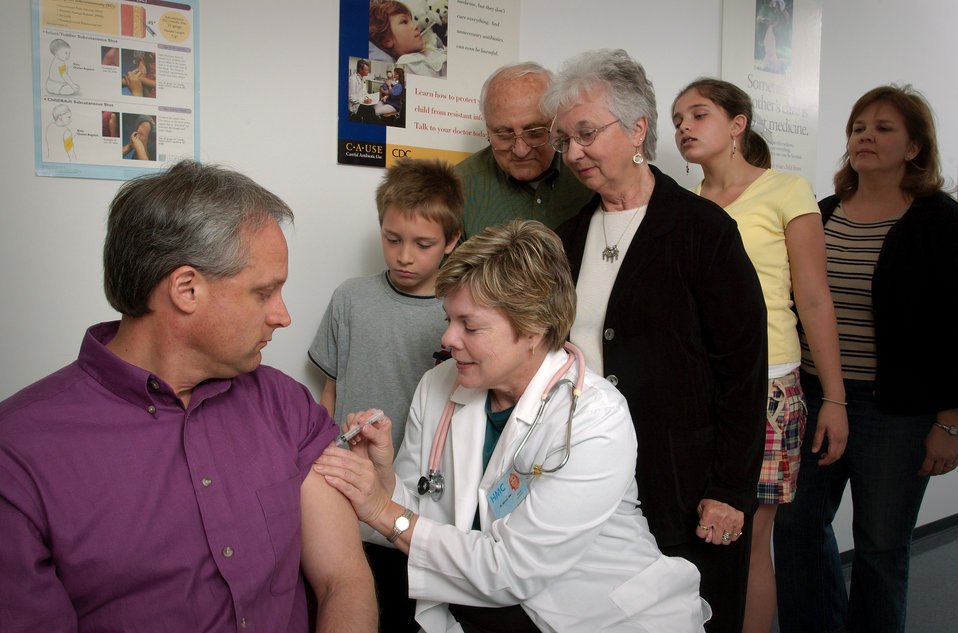 In this 2006 photograph, a man was receiving an intramuscular injection into the shoulder muscle of his left arm from a trained, registered