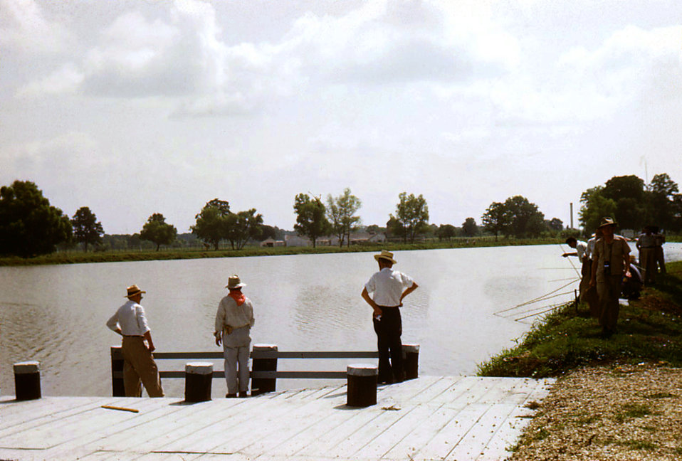 This historic image depicted a number of Carville, Louisiana Leprosarium patients as they were enjoying their usual Sunday outdoors fishing
