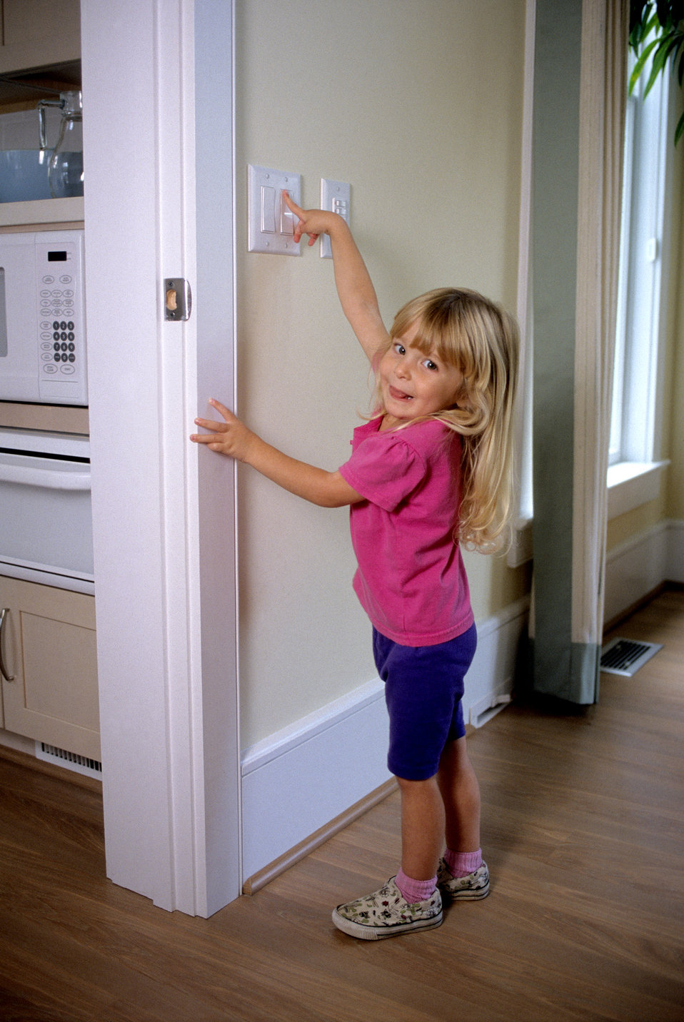 This 2000 image revealed that light switches that were lowered so that they were more reachable, might also be within reach of younger child