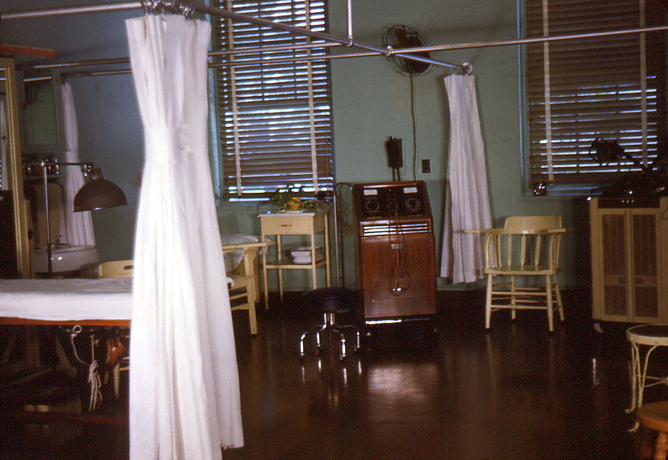 Depicted in this historic image was the interior of the Physical Therapy Room in the Carville, Louisiana Leprosarium. A staff nurse was plac