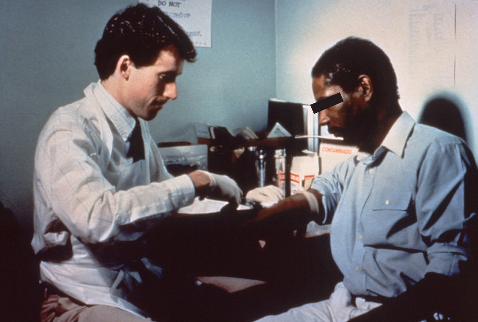 In this photograph, a CDC healthcare practitioner is examining a patient in a local STD clinic.
