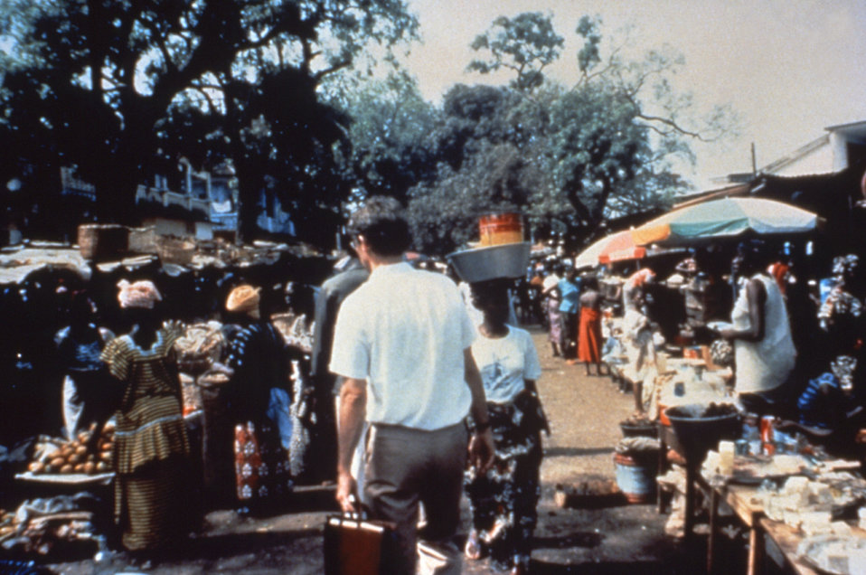This photograph shows an Epidemic Intelligence Service (EIS) officer walking through a market of a disease stricken country.