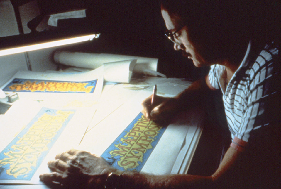This was CDC graphic artist Travis Benton working at his drafting table in DPDE's Creative Arts Branch, during the early 1980's.