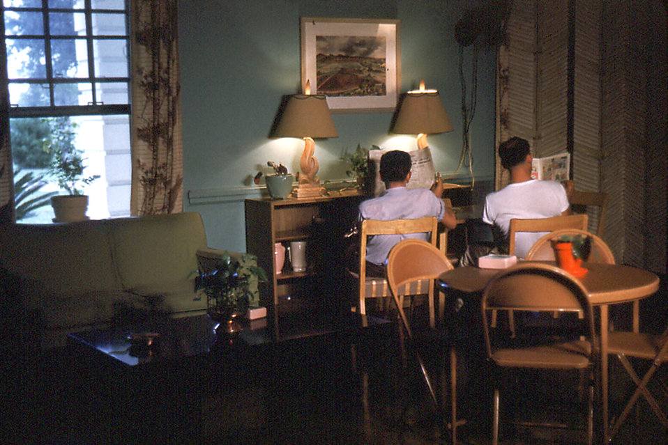 This historic image depicted typical scene one would encounter in the Carville, Louisiana Leprosarium's hospital lounge, where patients were