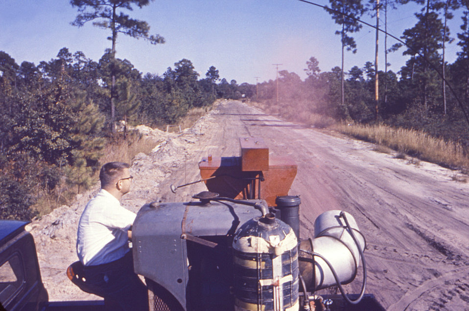 Driving a pick-up truck equipped with a Buffalo turbine blower, this historic 1962 image depicted a public health worker, as he was monitori