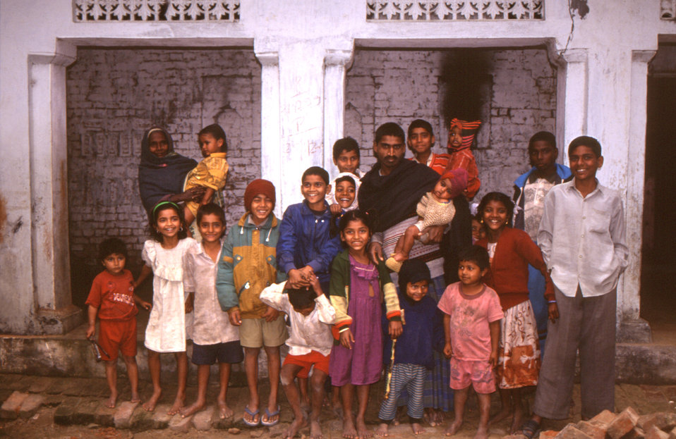 This 2000 photograph depicted a gathering of Indian family members posed outside their home, where they'd been visited by polio eradication