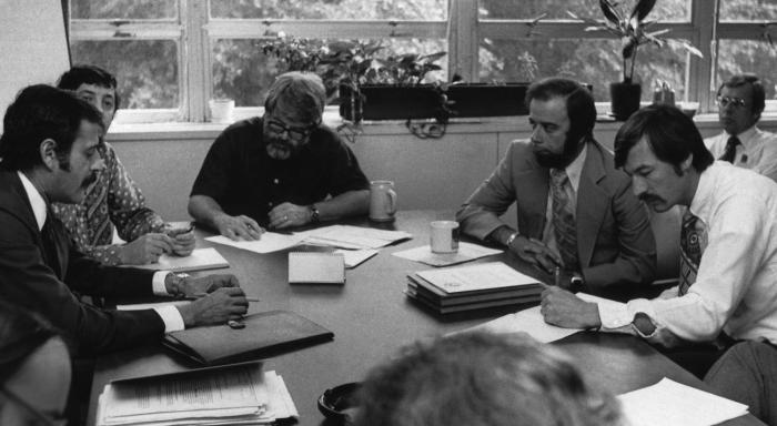 This 1976 photograph showed a meeting of a Centers for Disease Control task force. Such meetings gathered health officials who would collabo
