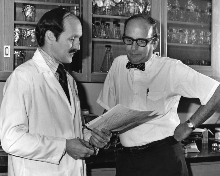 This 1976 photograph, taken at the Centers for Disease Control headquarters in Atlanta, Georgia, showed Gary Noble, M.D., M.P.H. (left) goin