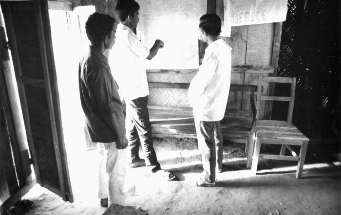 As members of the smallpox eradication team, these Bangladesh men, who were residents of this thana, were strategizing as to how to best cov