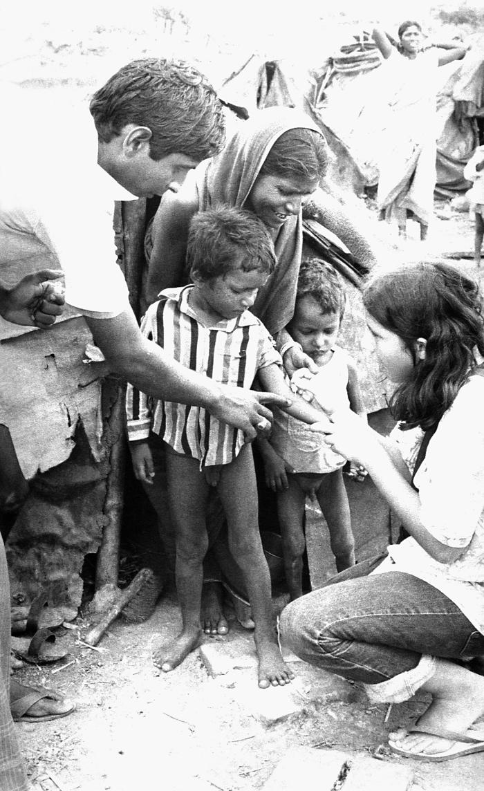 This smallpox eradication team vaccinator, Jennifer Alpern, a vacationing American student, was in the process of administering a vaccine to