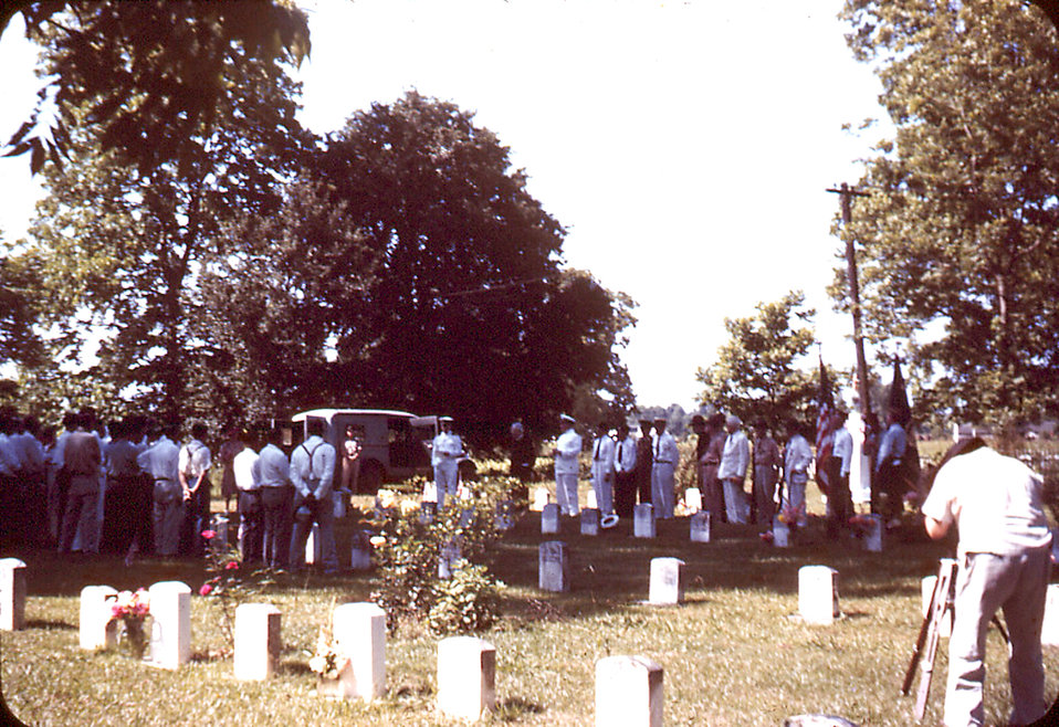 This historic image depicted a funeral on the grounds of the Carville, Louisiana Leprosarium, in honor of Sister Zoe, the only member of the