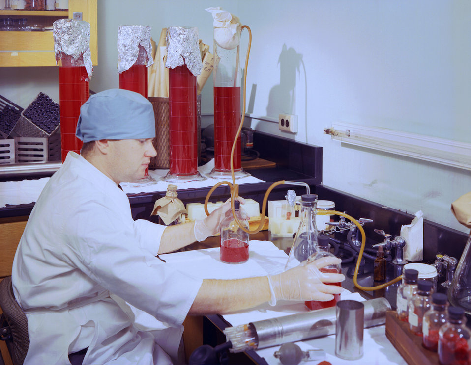 This historic 1963 photograph depicted laboratorian, Bill Hope, as he was processing horse blood, which would subsequently be used in the la