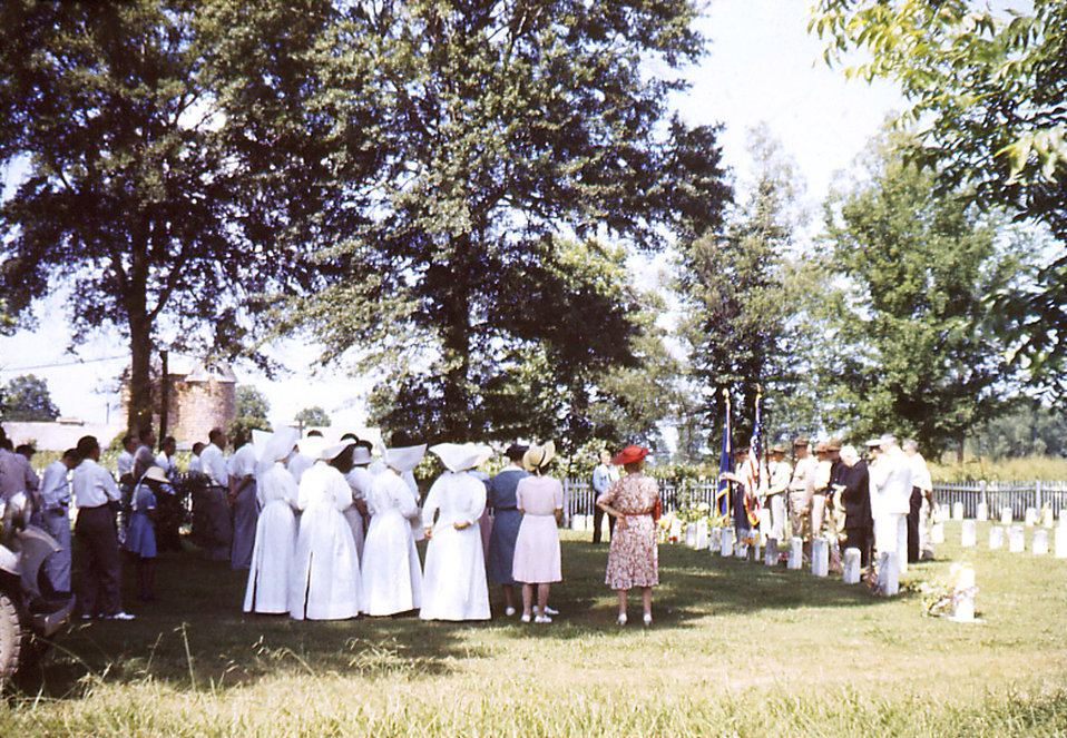Depicted in this historic image was a Memorial Day celebration on the grounds of the Carville, Louisiana Leprosarium, which was considered a