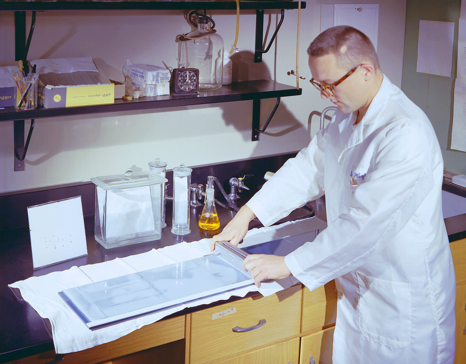 This historic 1963 photograph depicted laboratorian, Dr. Wylie, as he was preparing materials that would enable him to conduct a thin-layer