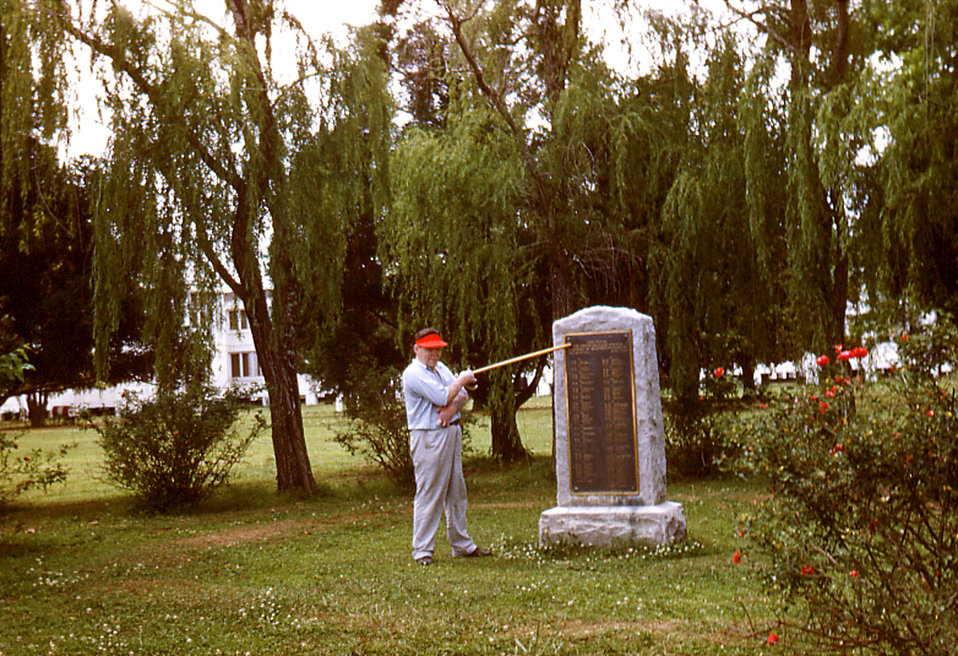 Depicted in this historic image was a Carville, Louisiana, Leprosarium patient as he was pointing his walking stick towards a stone marker p
