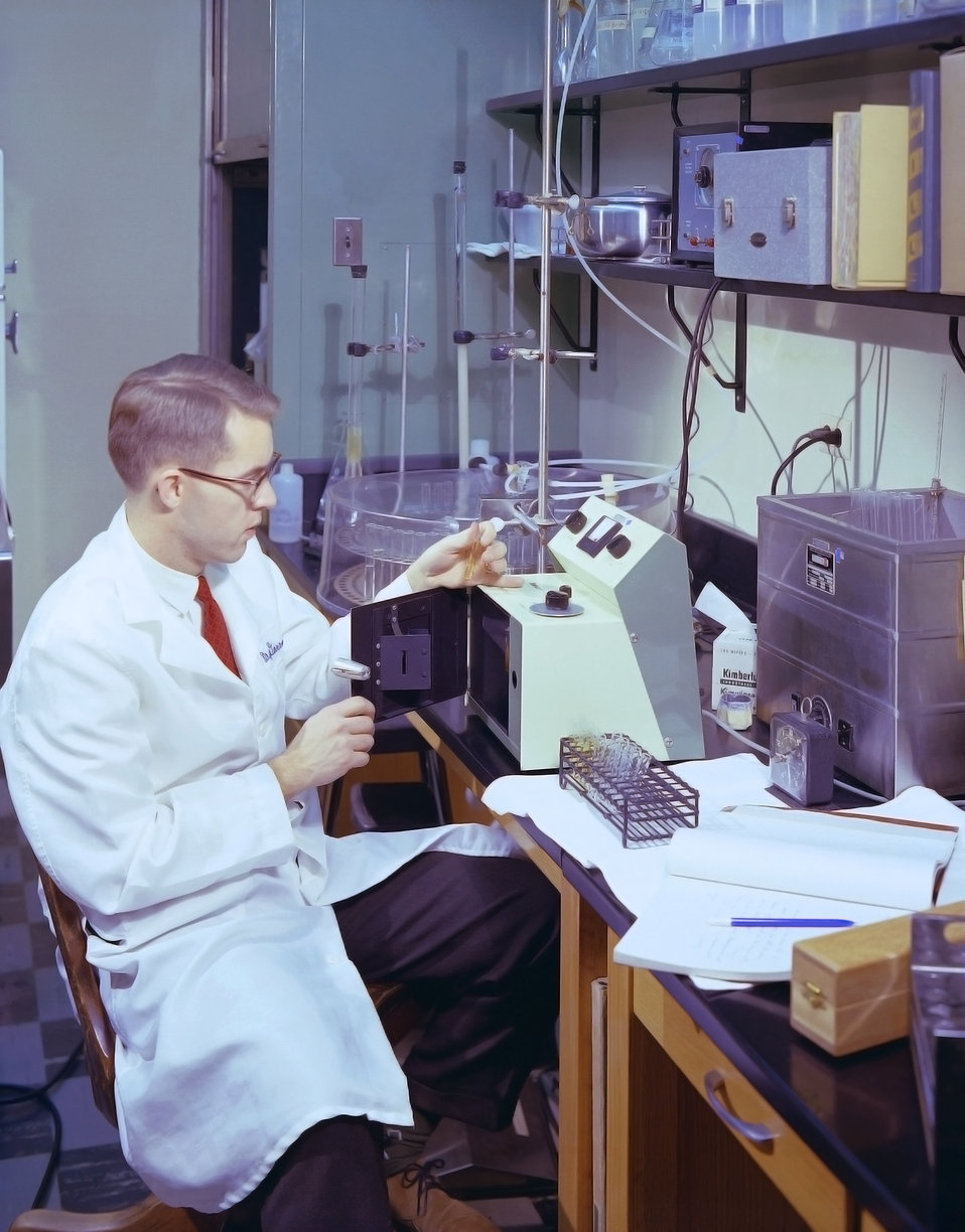 This historic 1963 photograph depicted laboratorian, Dr. Correttson, as he was performing a fluorometric test for phenylketonuria (PKU).
