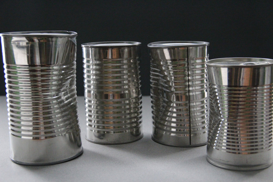 Depicted here, are four unlabeled metal cans containing unknown foods. The labels had been removed in order to remove any identifying data.