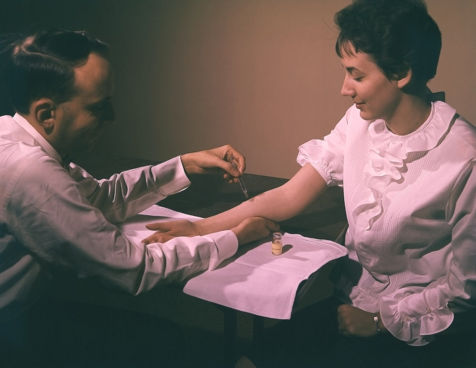 This 1962 photograph depicted a physician is in the process of administering a Mantoux tuberculin skin test (TST) in this recipient's right