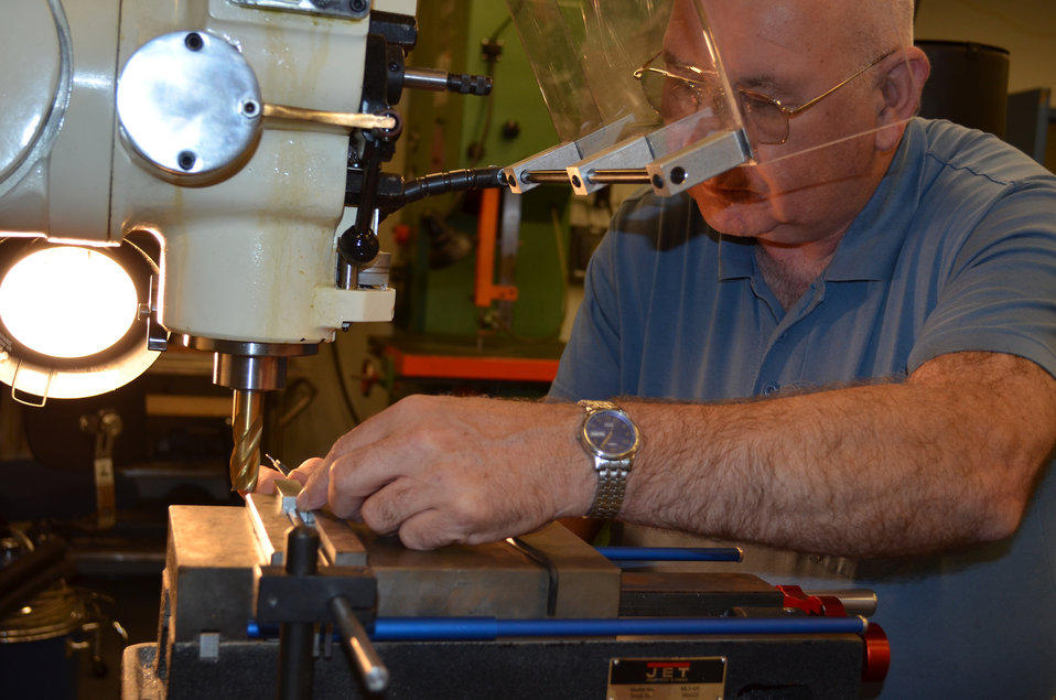 Photographed at a milling machine in his engineering suite, Engineering Technician, Mr. Jerry Kratzer, a member of the Engineering & Physica