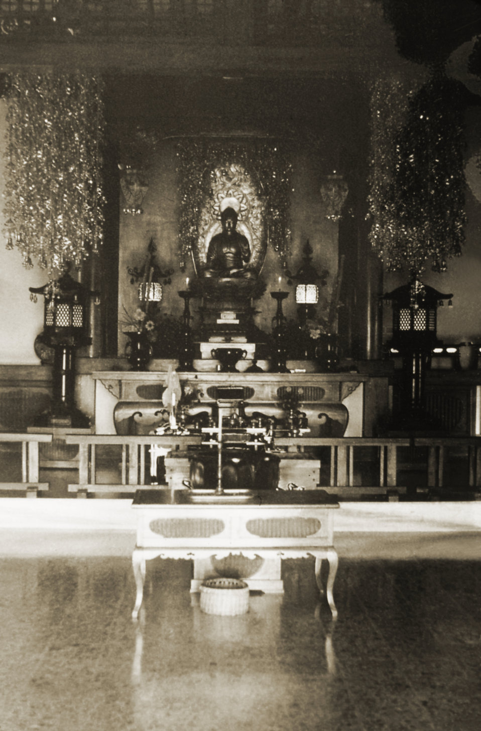 This image depicts the interior of a Japanese Buddhist temple, which was located in Bodh Gaya, a revered religious site located in the Gaya