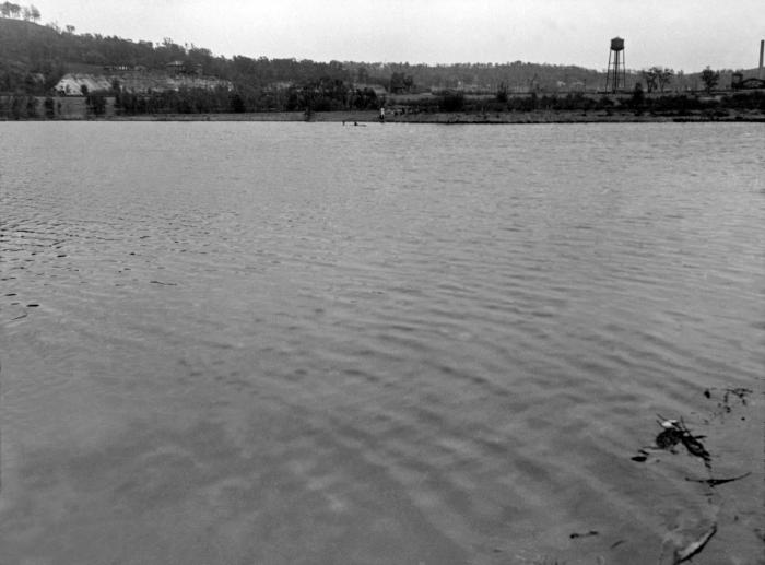 This historic image depicted some swimmers in the Mississippi River near Holman Airport, St. Paul, Minnesota, May 20, 1933. It was taken dur