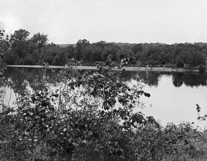 This historic photograph depicted a number of young men who were swimming in the Mississippi River below Pike Island, June 13, 1933. It was