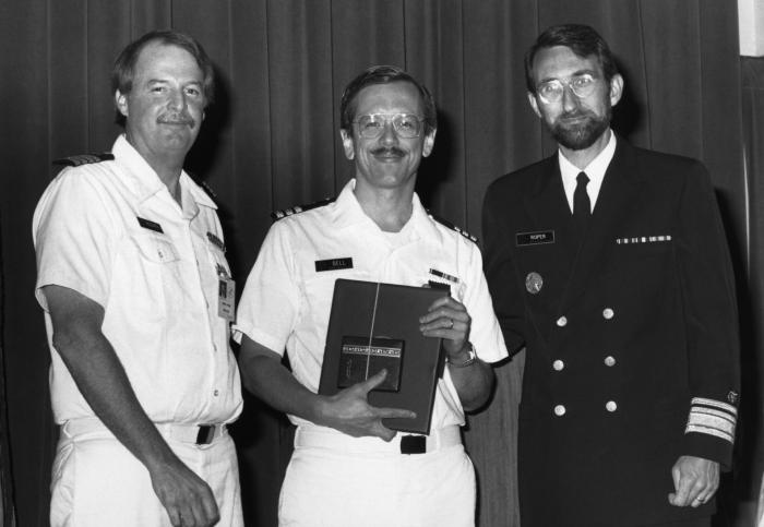 This photograph shows Dr. James Hughes (left), head of the Centers for Disease Control's National Center for Infectious Diseases (NCID), and
