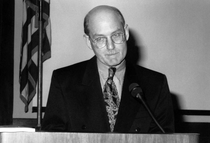 This photograph shows Centers for Disease Control Research Microbiologist, Dr. Joseph E. McDade, as he was presenting an overview of the Sou