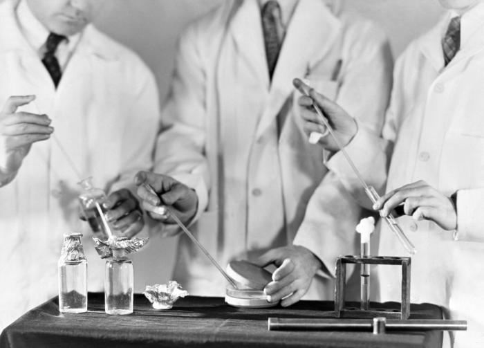 This historic 1931 photograph showed the three steps to be taken in the examination of water for bacteria. Left to right, they are: (1) remo