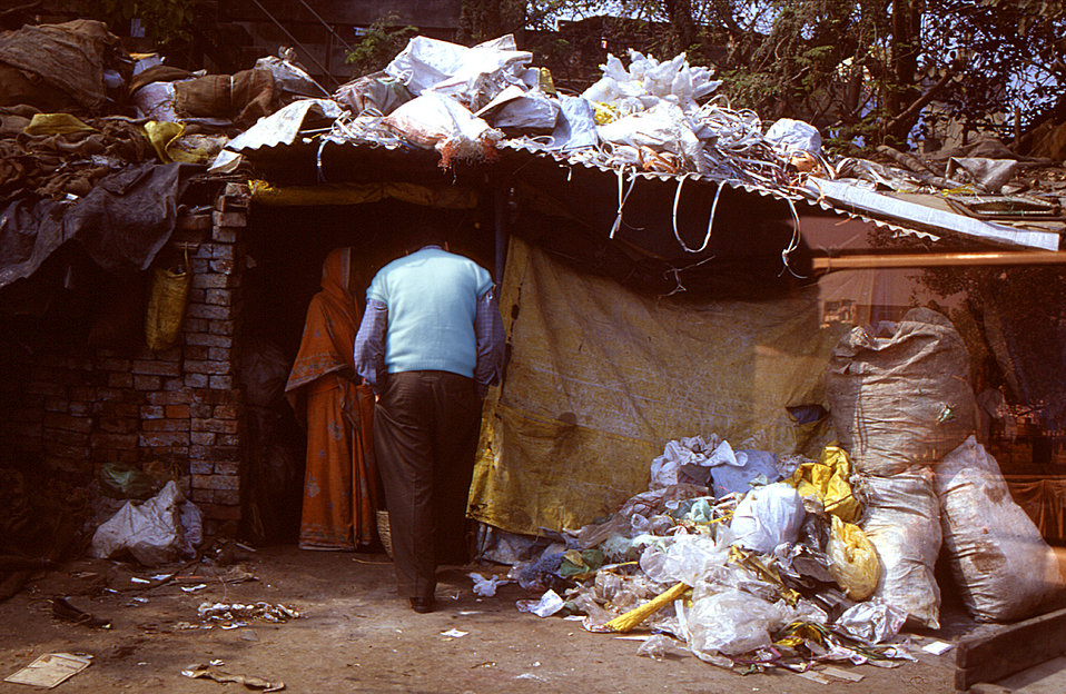 Wearing a blue-colored sweater, this 2000 image depicted Dr. Bharti, the Varanasi Surveillance Medical Officer, as he was visiting this slum