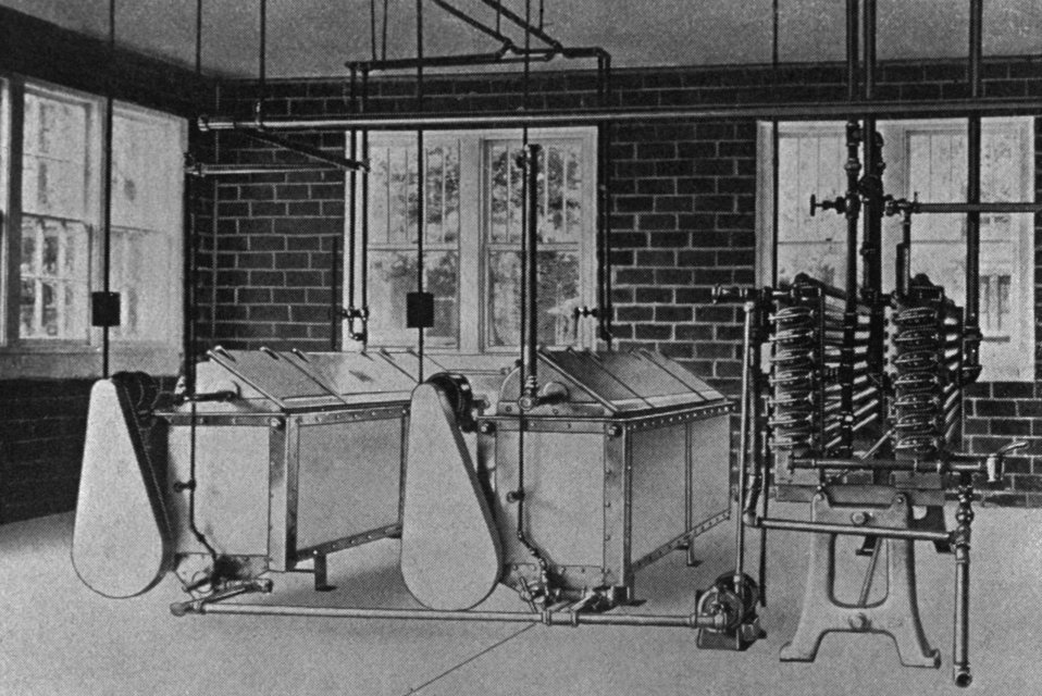 This historic 1929 photograph depicted a 'vat' type pasteurizer and milk cooler, examples of which could be found in properly operated Minne