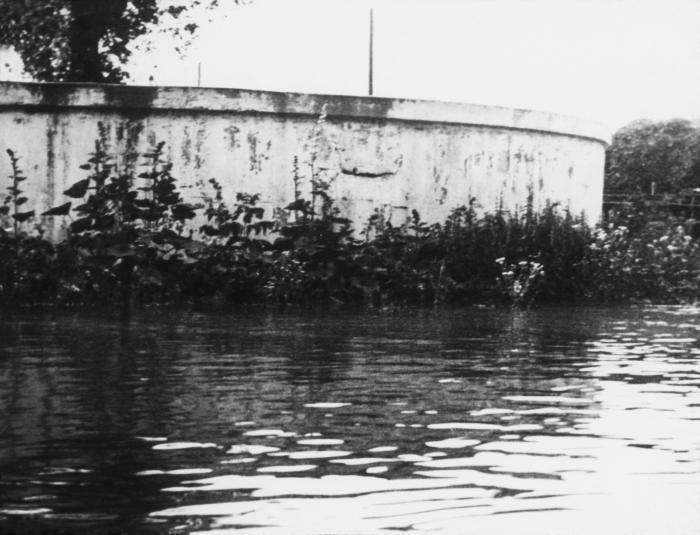 This historic 1939 photograph depicted a flooded 'dug' well in Luverne, Minnesota. Potable water sources can become contaminated with the ba