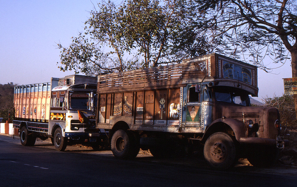 This 2000 photograph depicted two large trucks, the likes of which are often seen driving along the roadways of India. These two vehicles we