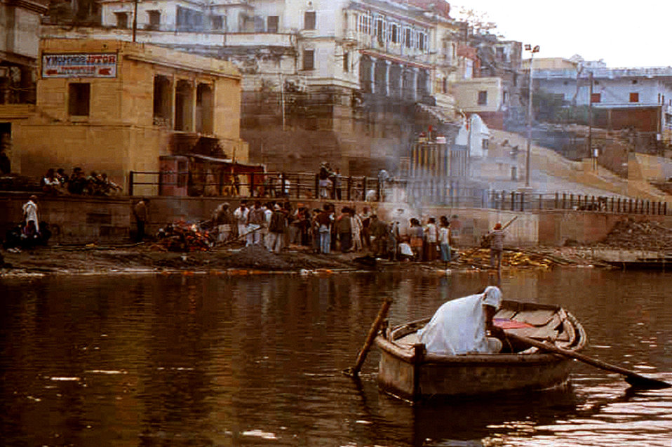 This 2000 photograph depicted a number of individuals gathered at a cremation ceremony on the banks of the Ganges River, in Varanasi, India.