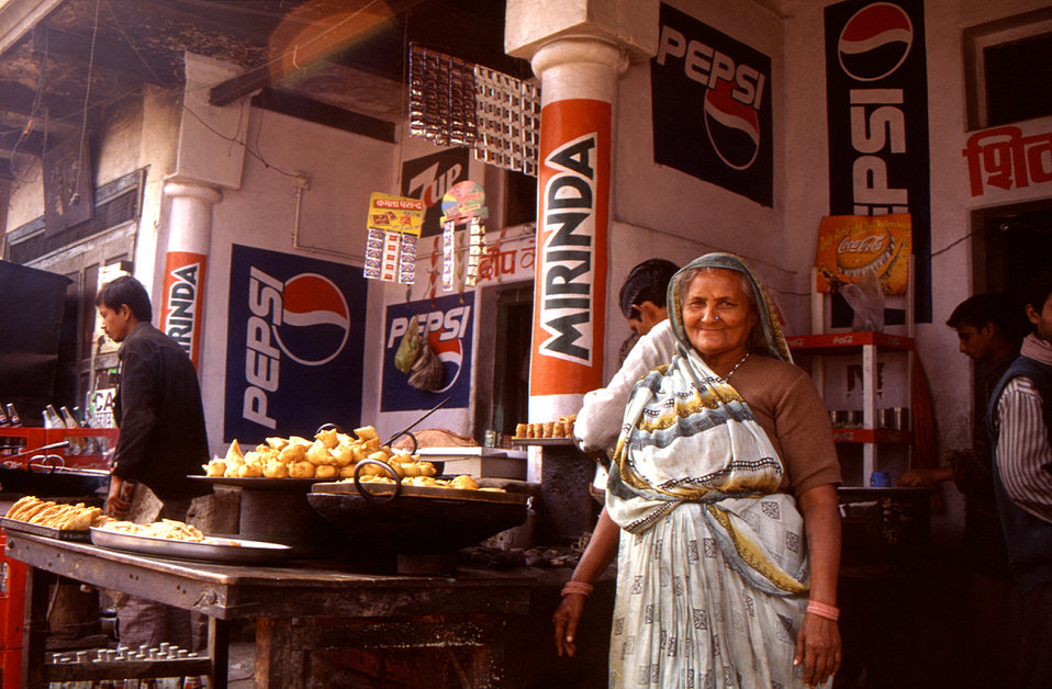 Proudly standing outside her food stall, was this elderly woman who was selling her produce to patrons in one of India's many popular street