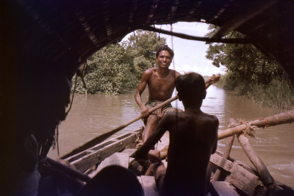 This photograph, which was captured in September, 1975, depicted a view from the inside of a country boat. The boat and its passengers were