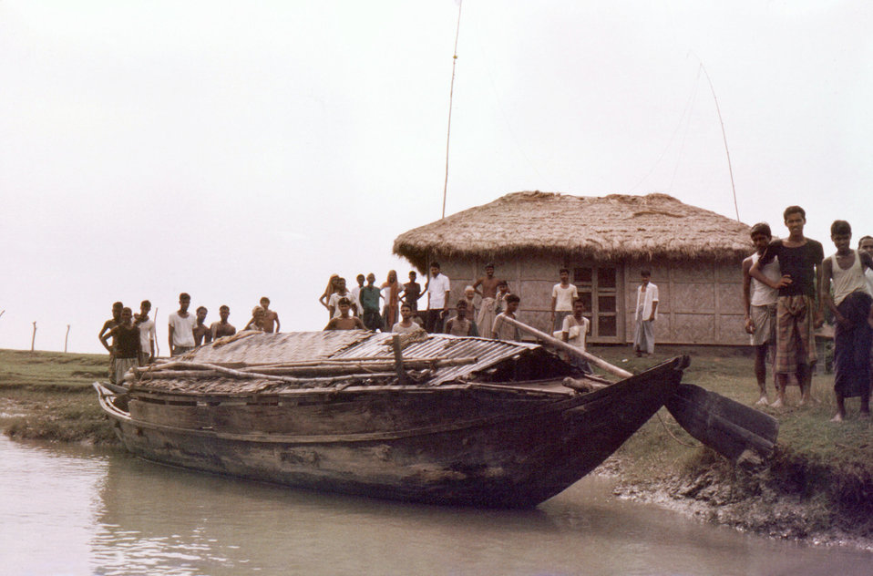 This September, 1975 photograph, depicted a beached boat in front of the 'Lord Harding Bazaar' Smallpox Office, on Bangladesh's largest isla
