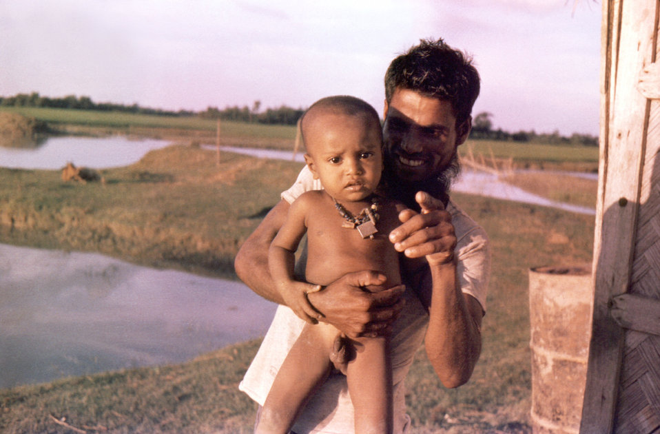 This September, 1975 photograph, showed Ali Usus, the cook at the 'Lord Harding Bazaar' smallpox outbreak site, holding his young son. The B
