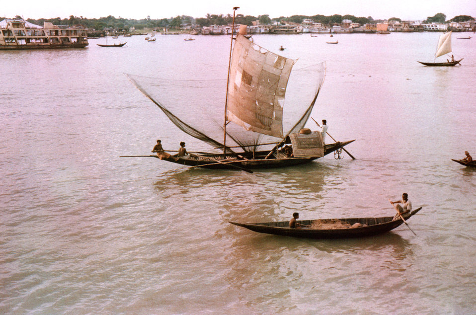 Depicted here in this September, 1975 image, were river craft using the Meghna River as a mode of transport, and industry. Included in this