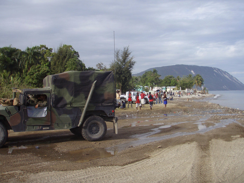 This image depicts a convoy of U.S. Marines who'd been transported by the USS Bataan to Haiti in order to provide security to responders dur