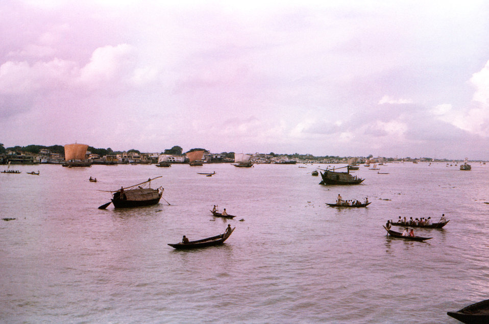This image depicted a number of 'sampan walas', or ferryboats, as they plied the Meghna River, in the Dhaka District of Bangladesh, en route