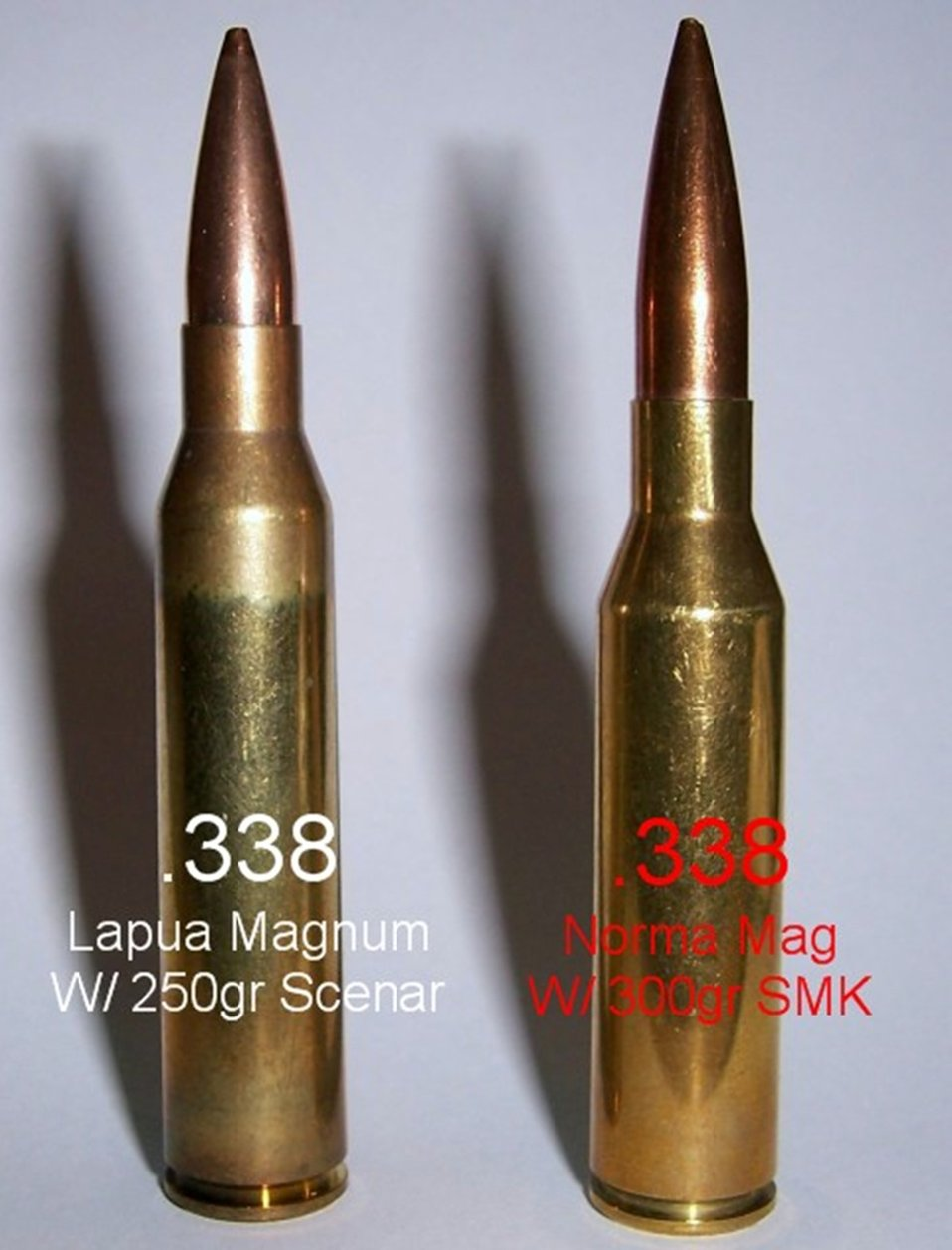 This image is a side by side comparison of the .338 Lapua Magnum cartridge to the .338 Norma Magnum cartridge.