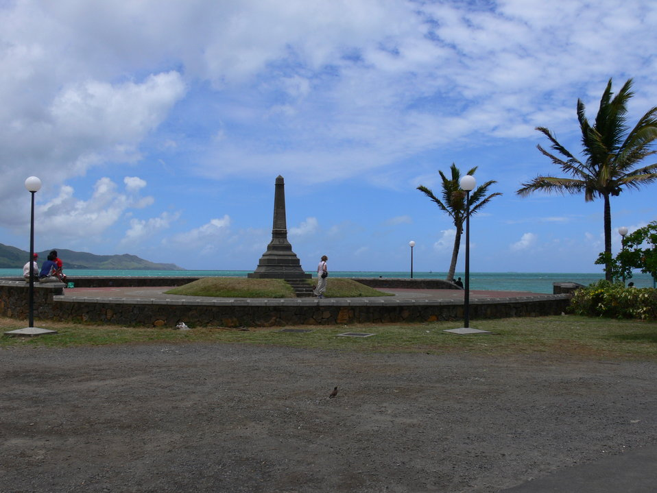 This photograph was made by myself at Grand-Port Mauritius, in the graceful year of 2007 with the digital camera Panasonic FZ-30. This is the monument dedicated to the 1810 battle between French and British navy. This is the bay were all this happened. Th