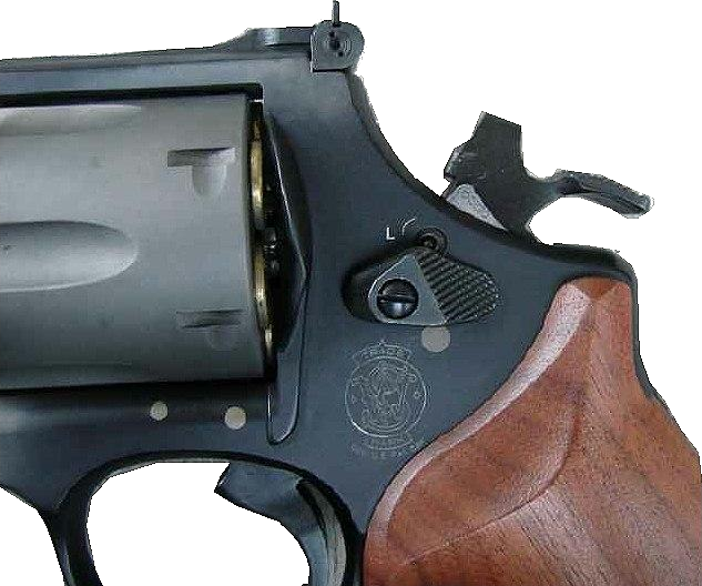 Lock failure on an S&W 329. The lock failed two times consecutively while firing 240 gr .44 Magnum loads. The hammer rebounded back part way and the flag came up temporarily tying the revolver up. The flag would drop and the revolver would function normal