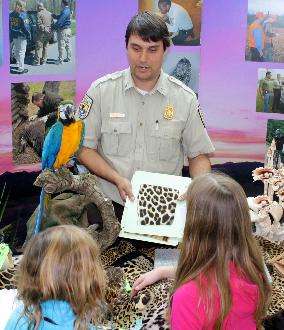 Wildlife Inspector explaining furs