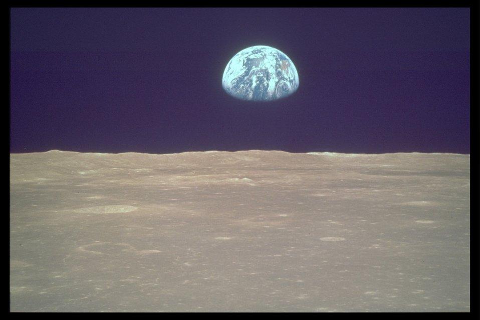 NASA earthrise (earth with moon landscape).