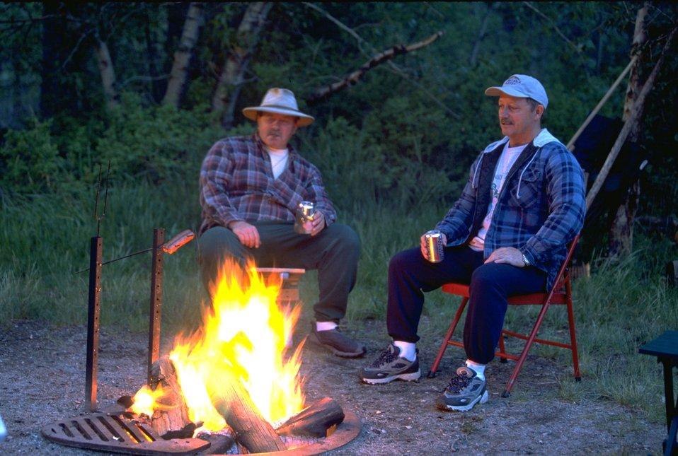 Campers enjoying an evening campfire