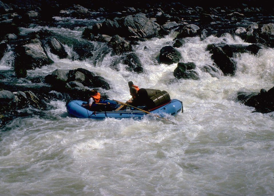 Rafting through the whitewater of the Middle Chute of the Rainie River.